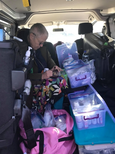 Tama managing the pharmacy in the gorilla van.
