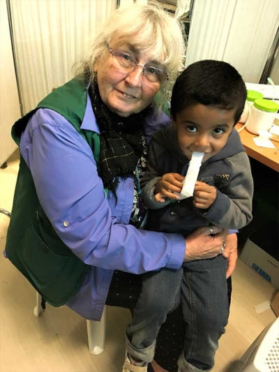 Valerie with young refugee boy