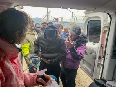 Dr. Mark attending to refugees.